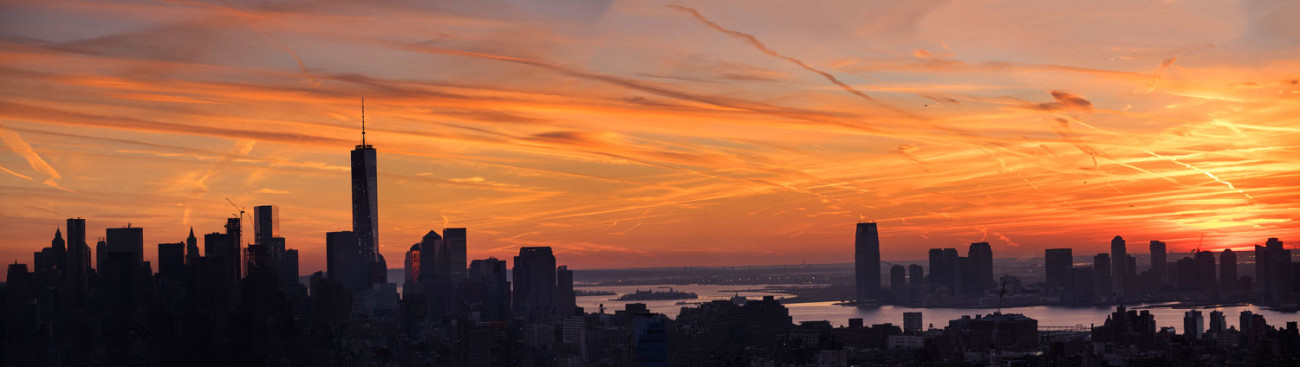 Lower Manhattan sunset silhouette and jet trails, NY, 2014