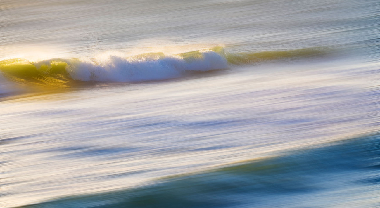 Breaking wave at sunrise, Florida, 2015