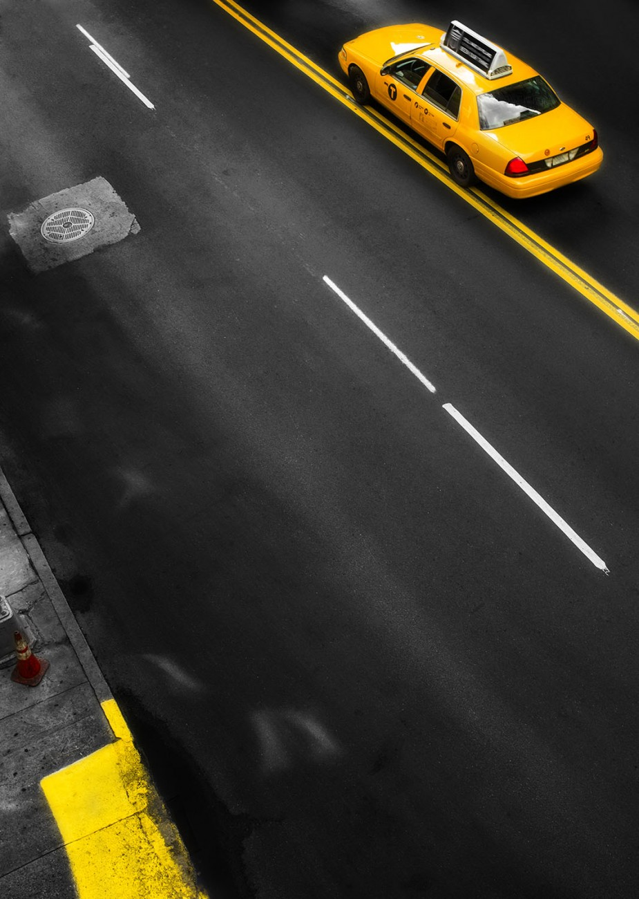 Taxi with double yellow line, NY, 2012