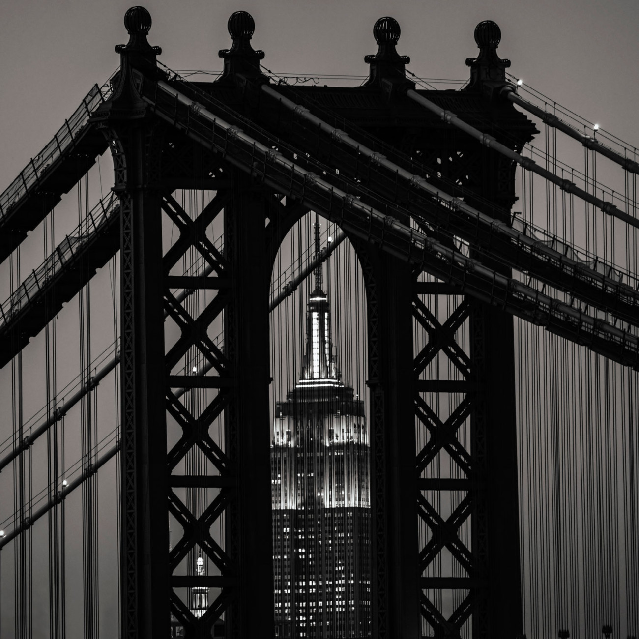 Empire State Building through the Manhattan Bridge, black and wh