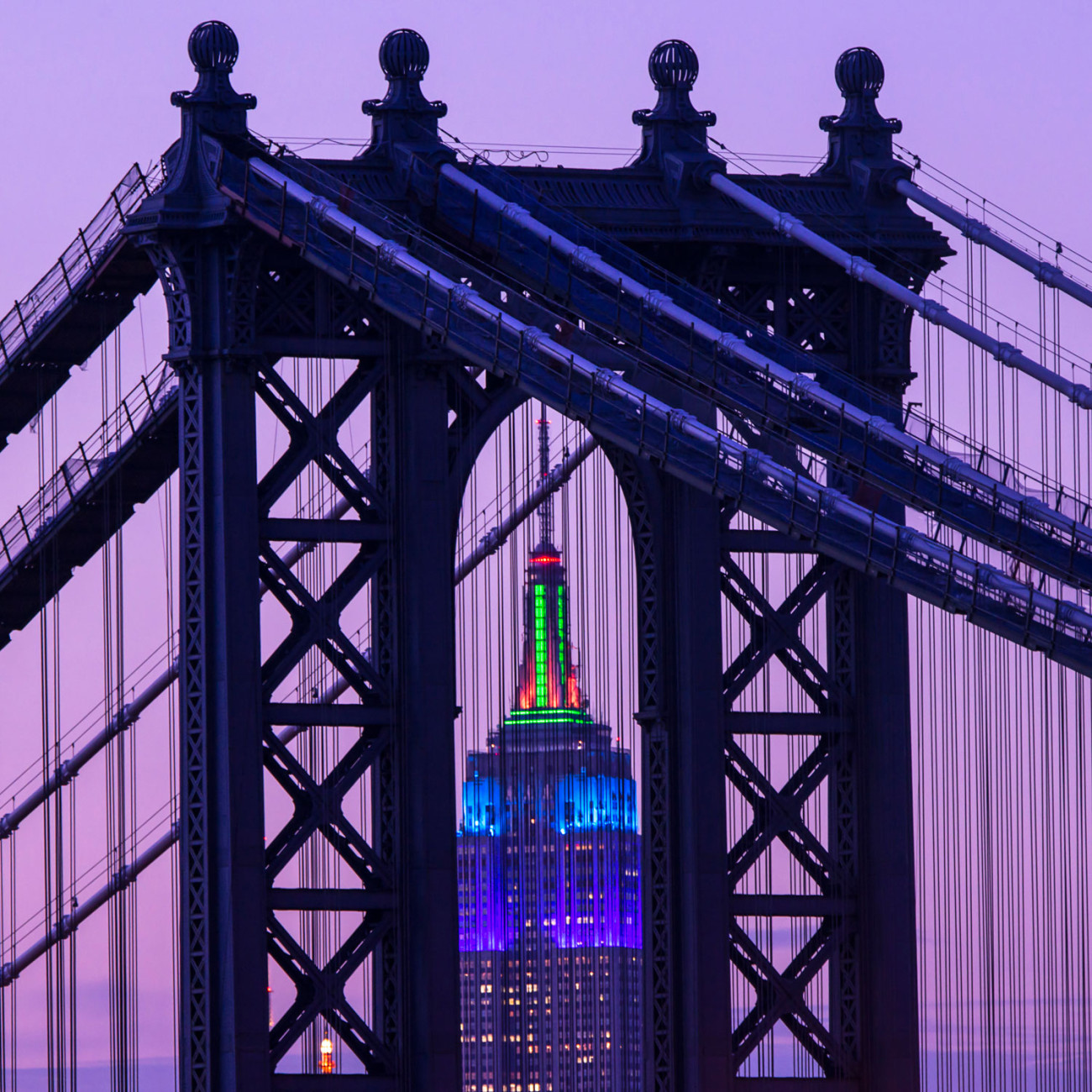 Purple on the Empire State Building through the Manhattan Bridge