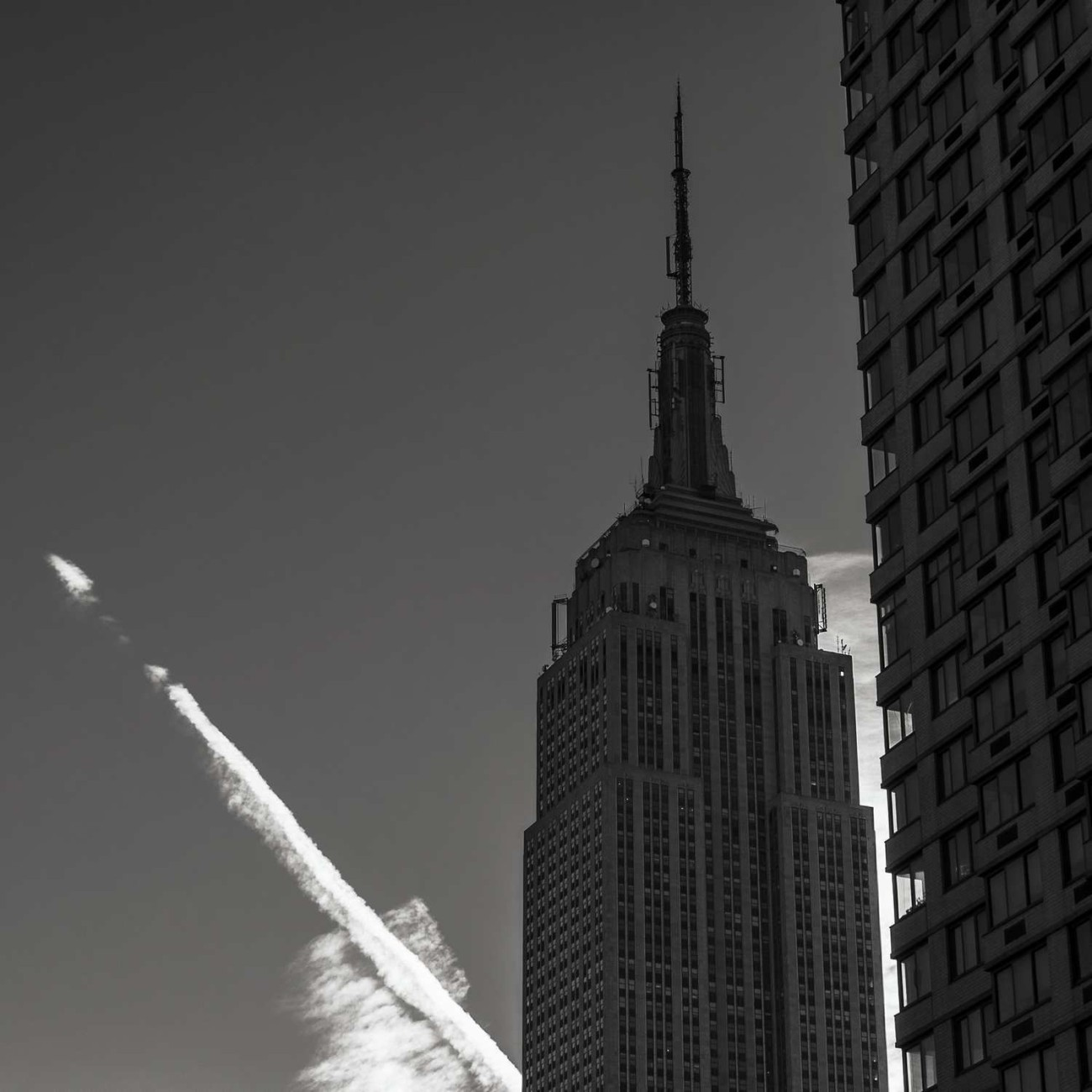 Empire State Building and contrail, New York, 2014