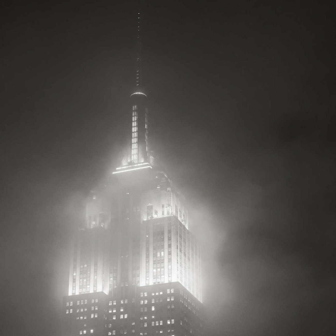 Empire State Building and passing cloud at night, NY, 2014