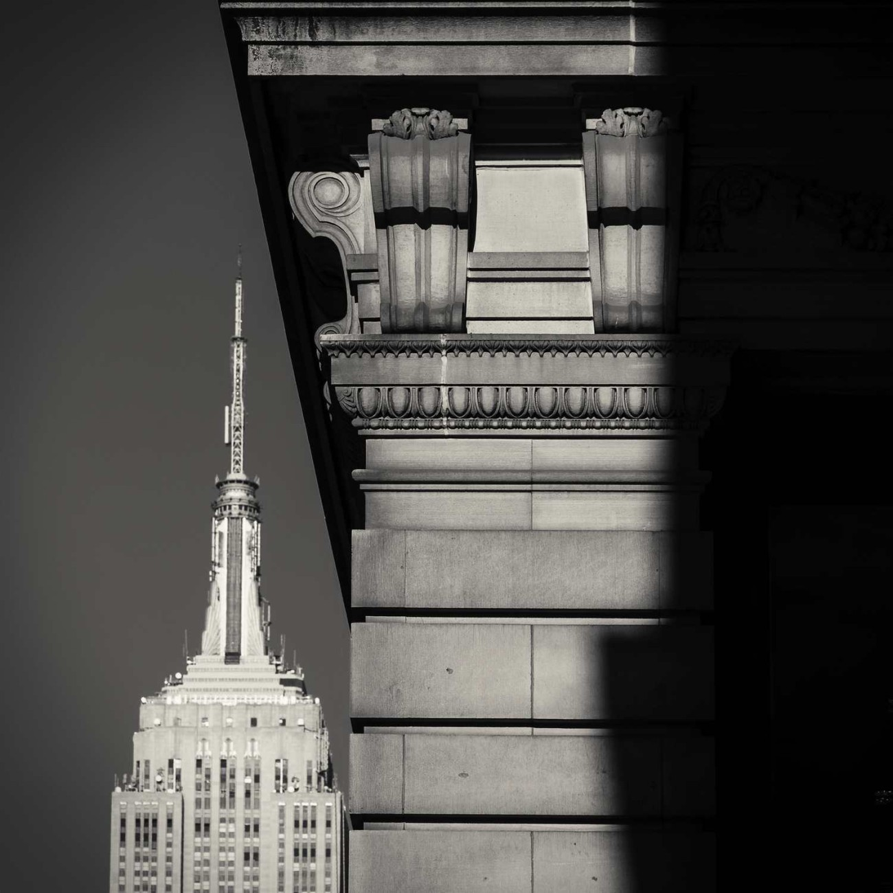 Empire State Building tower and cornice with shadow, New York, 2