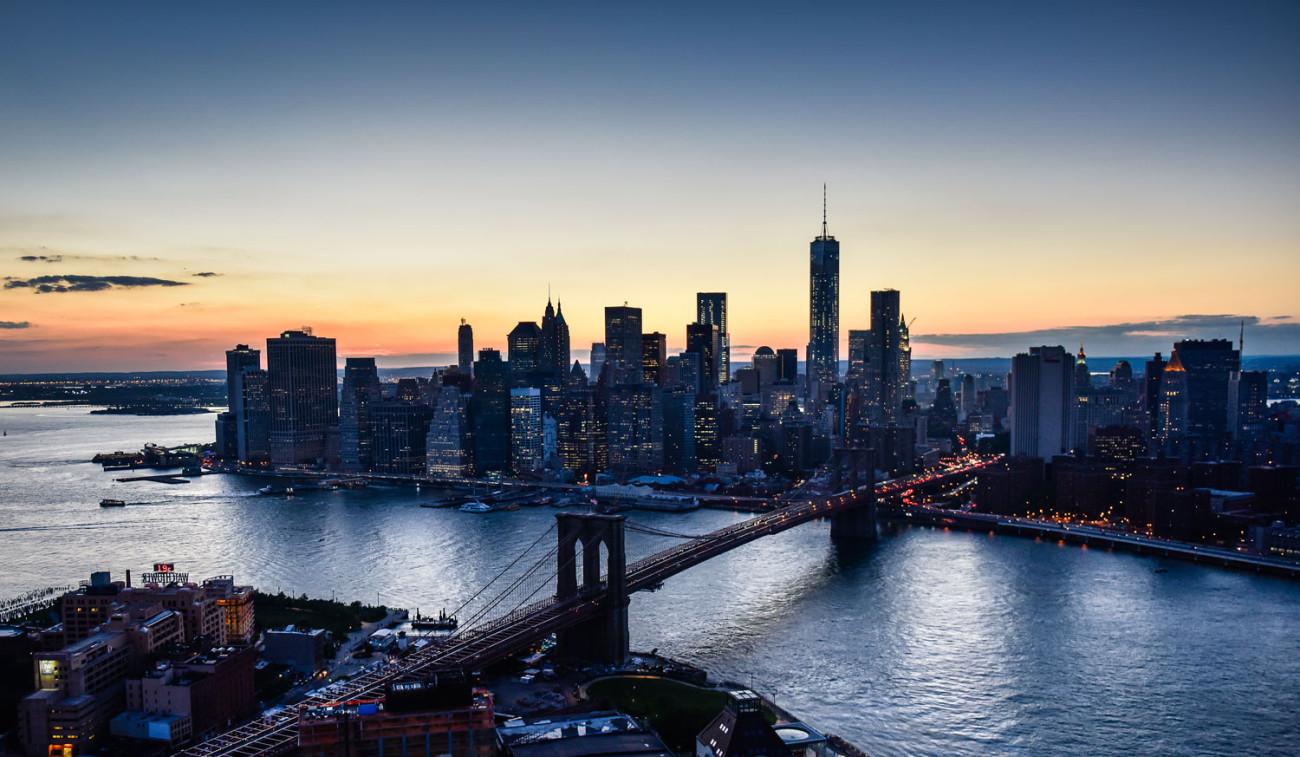 Brooklyn Bridge and lower Manhattan at dusk, aerial, NY, 2014