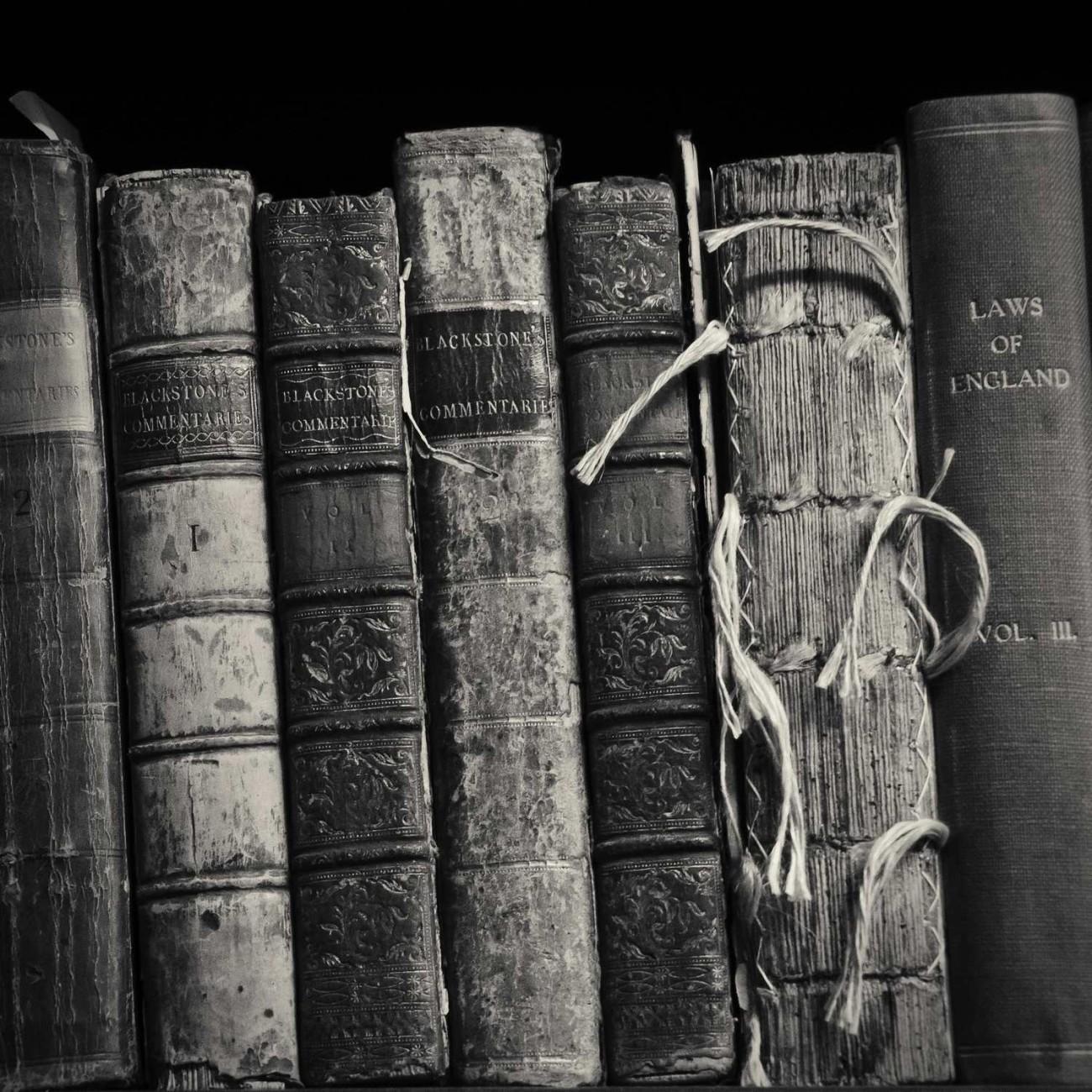 Seven books on a shelf, England, 2010