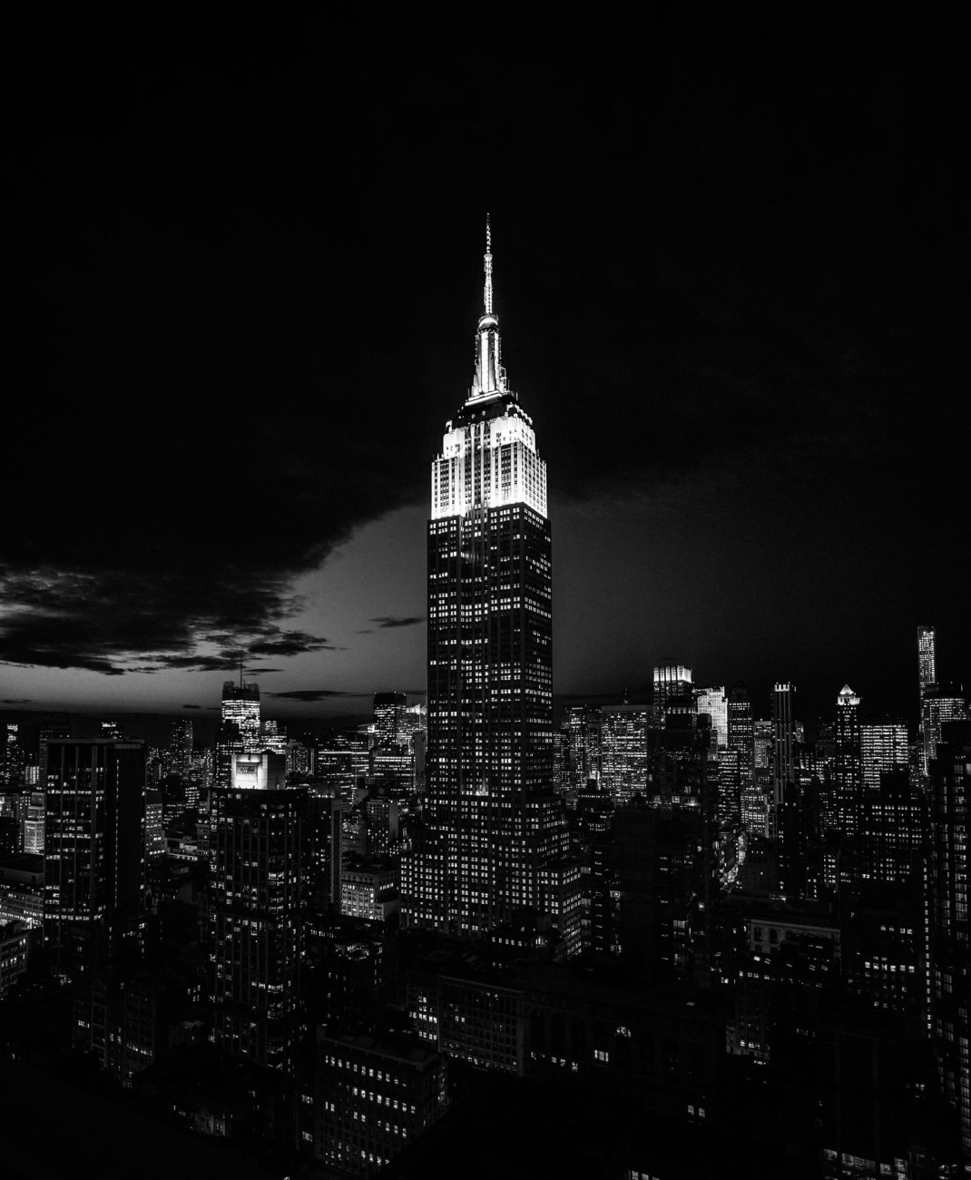 Empire State Building at night with city lights, NY, 2015