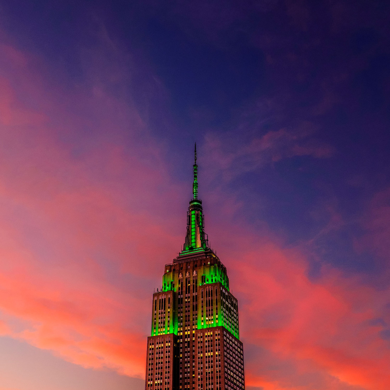 Empire State Building lit green at dusk, NY, 2015