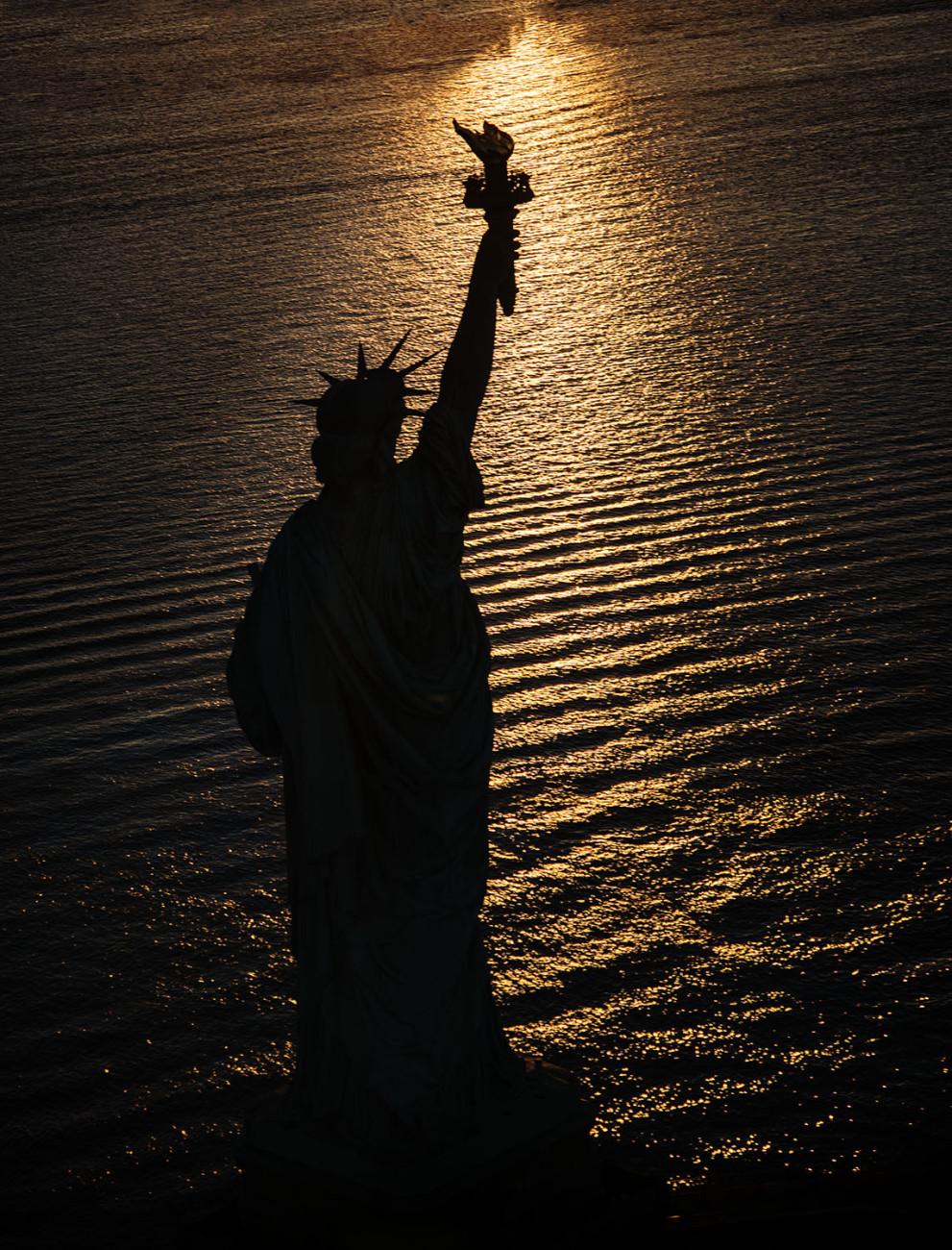 Dawn reflections Statue of Liberty, NY, 2016
