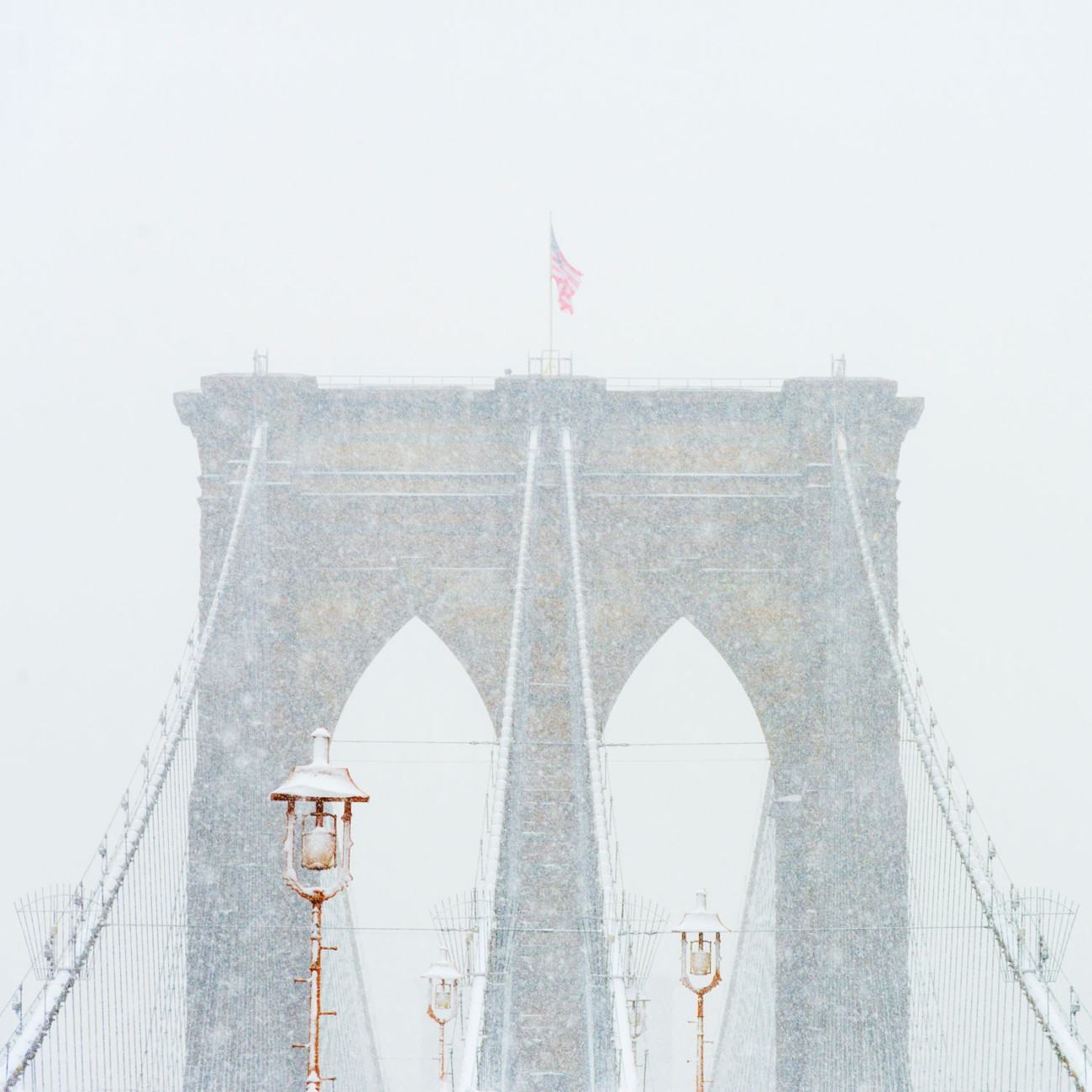 Tower of the Brooklyn Bridge in snow, NY, 2013