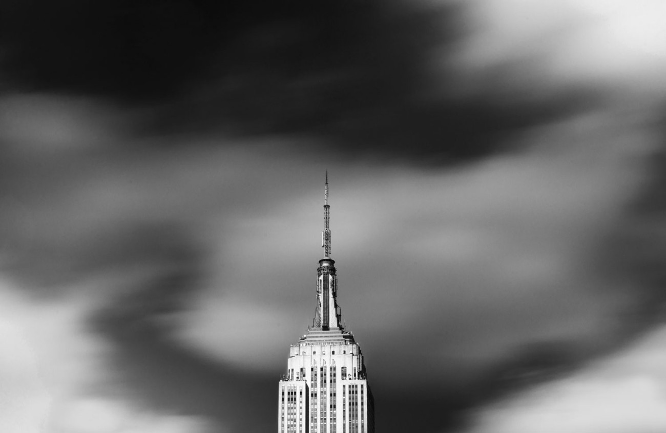 Empire State Building with passing clouds, NY, 2013