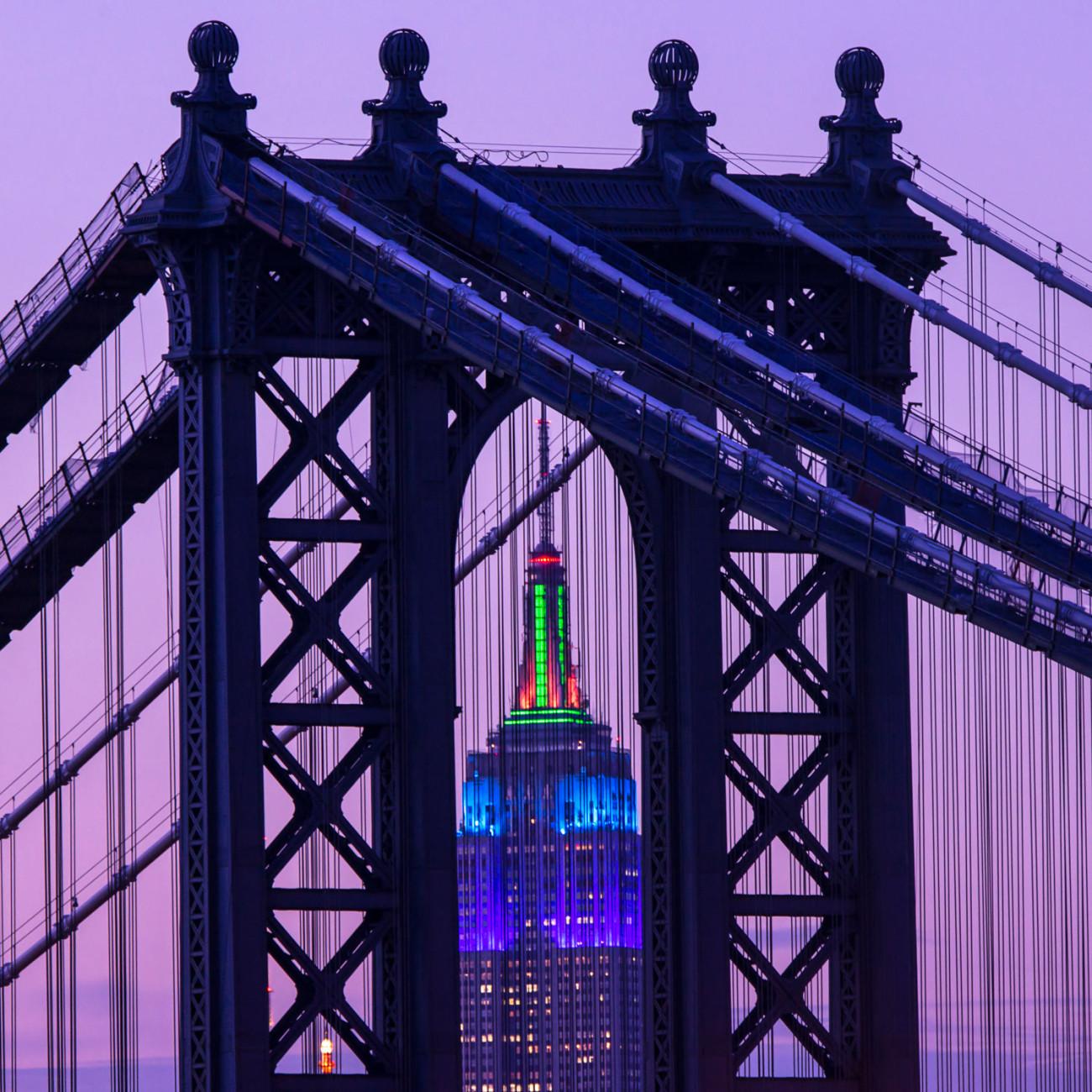 Purple on the Empire State Building through the Manhattan Bridge