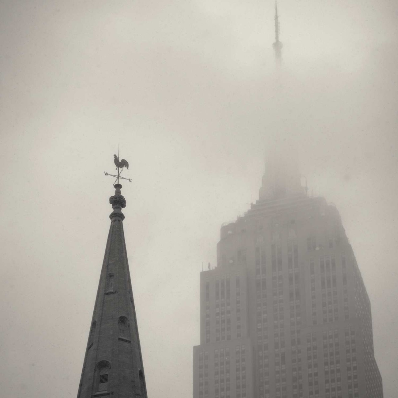 Empire State Building and steeple in fog, NY, 2014
