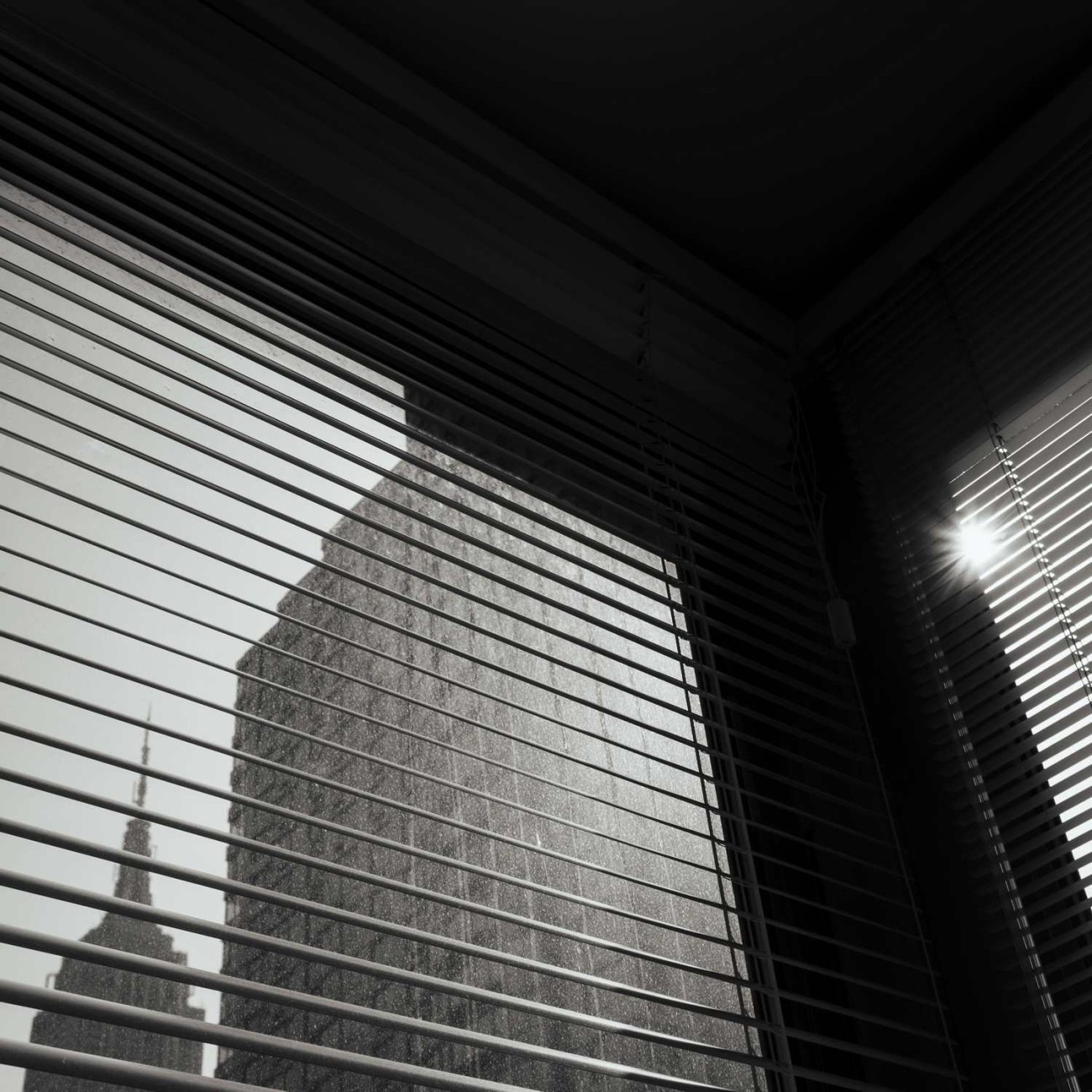 Sunrise and blinds with Empire State Building, New York, 2014